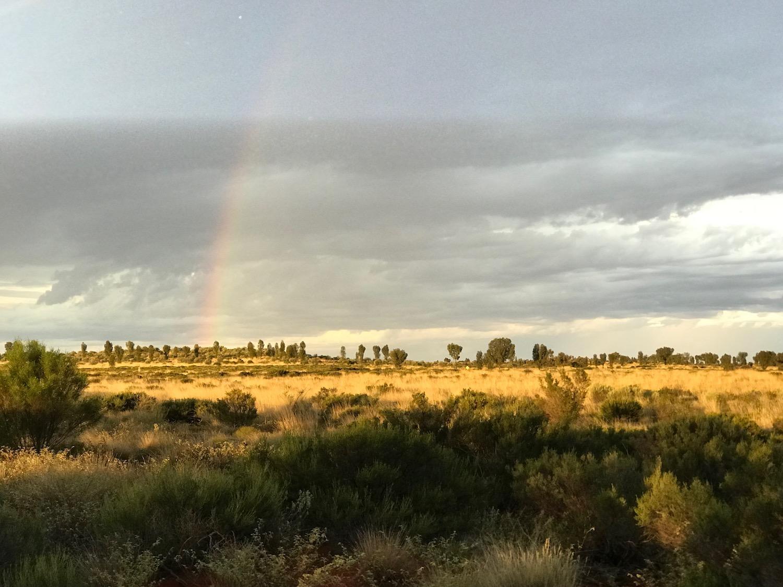 A lucky sunset with a rainbow!