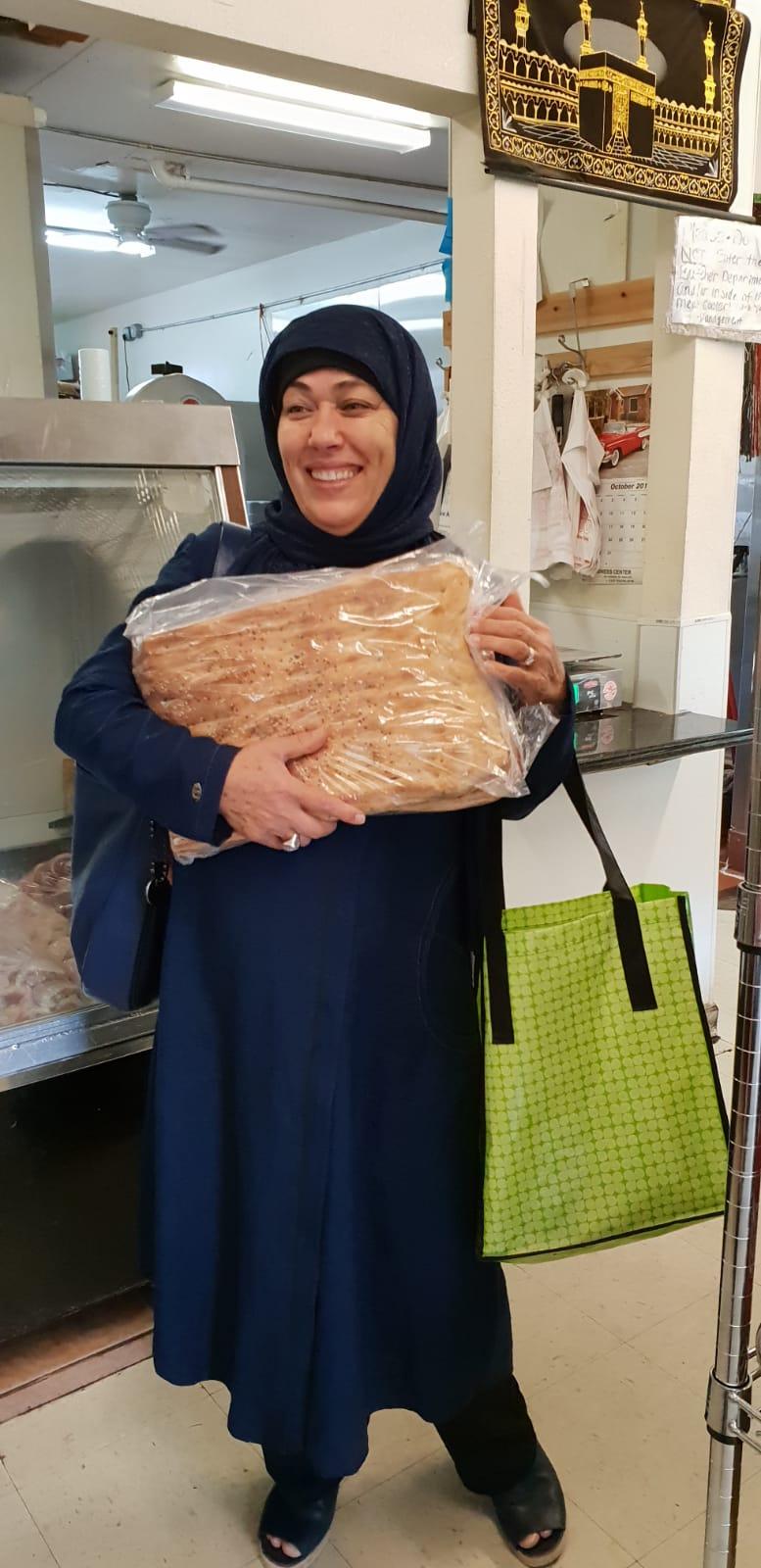 Basema hugging the yummy Afghani feshly baked bread